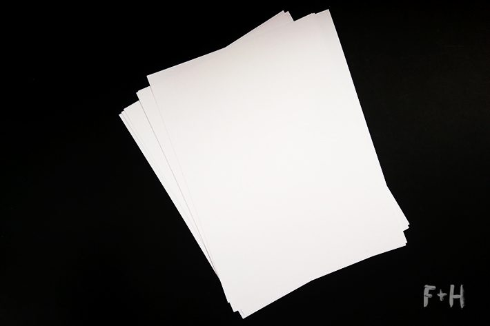 white cardstock on black background