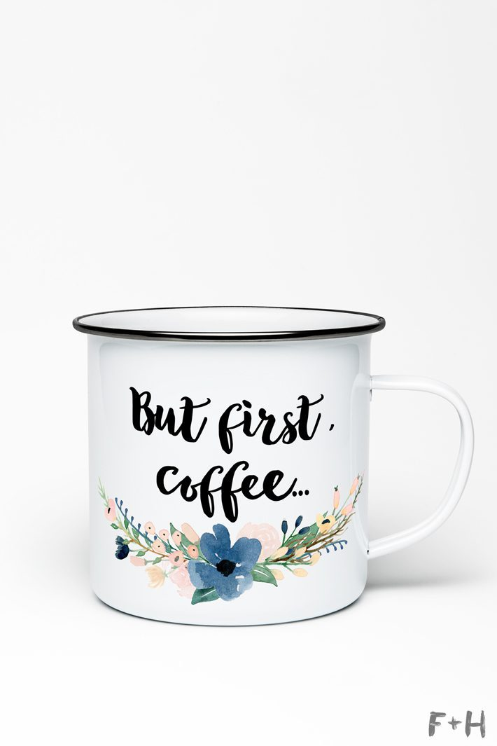 white enamel coffee mug with writing and flowers