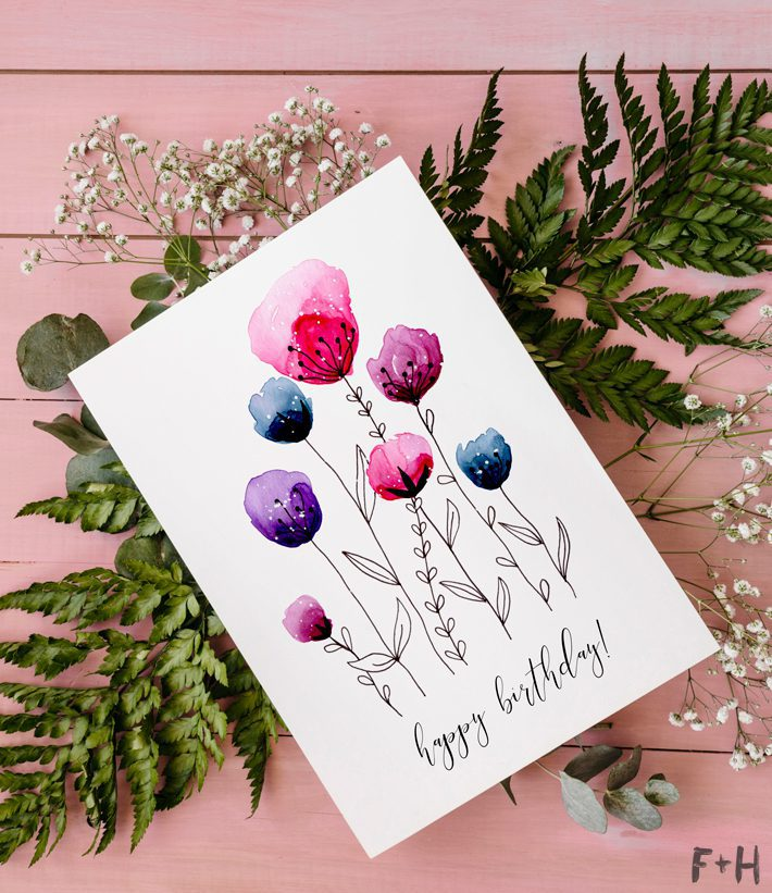 floral watercolor birthday card on flowers on pink background