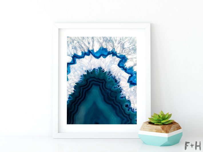 blue agate print in white frame with potted succulent