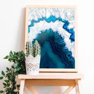 blue agate art print in wood frame on wood stool with plants