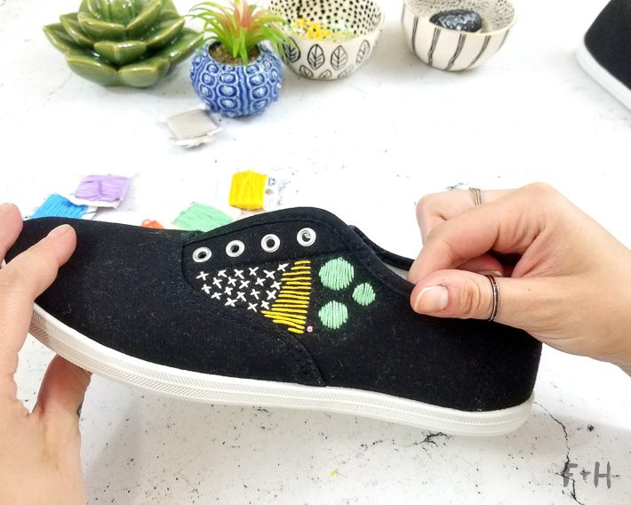 black embroidered canvas shoes on desktop