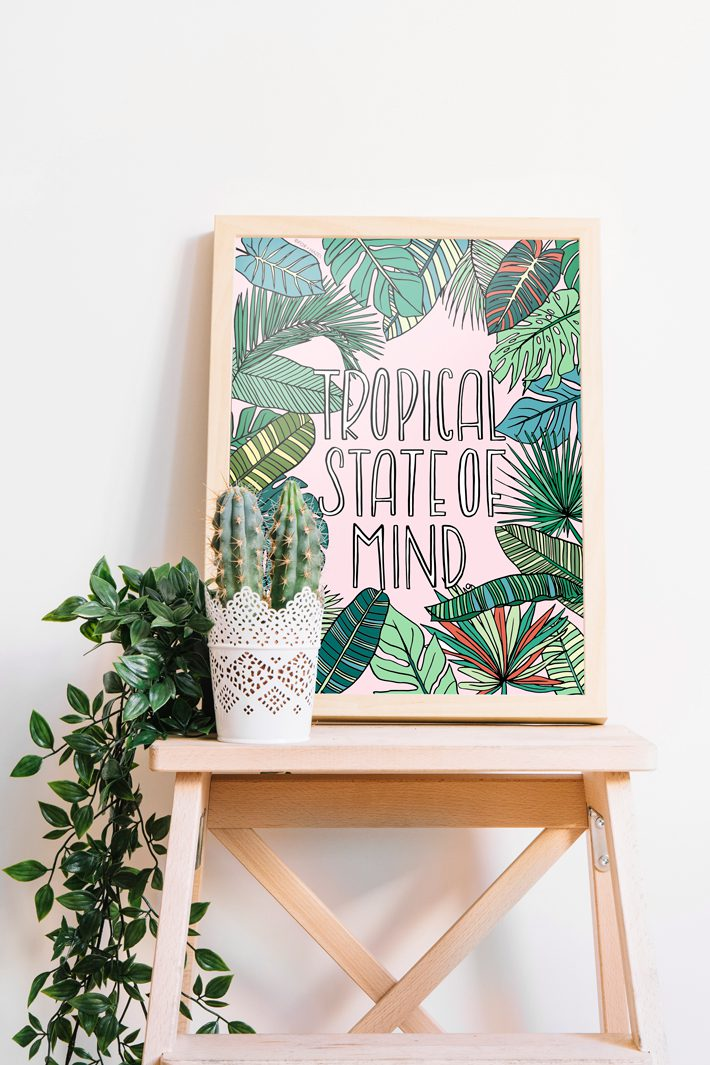 tropical art print in frame on stool