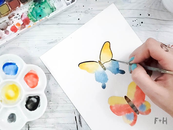 painting yellow and blue butterfly in watercolor