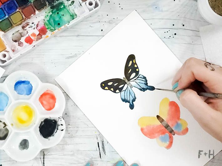 watercolor painted butterflies on desk