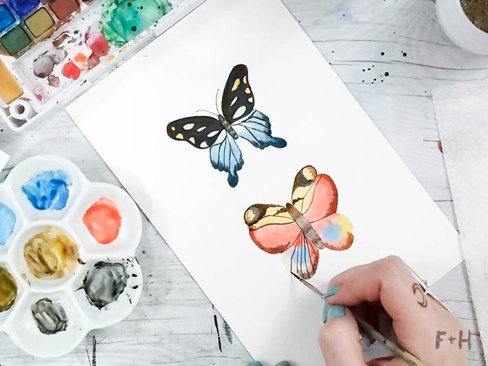 painted watercolor butterflies on white desk