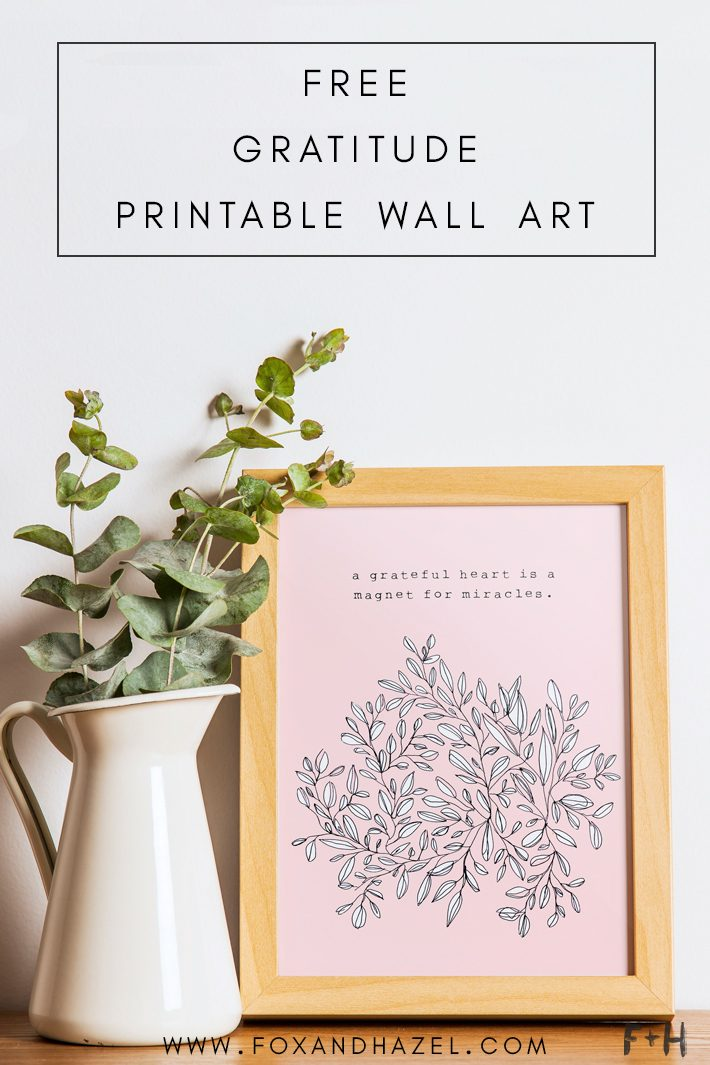 pink inspirational quote art in frame on desk