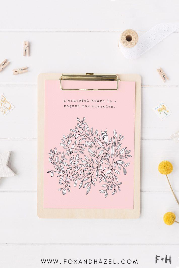 pink gratitude print on clipboard on white desk